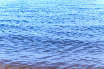 Blue clear water. Sea, lake, sun, beach, vacation Background for inserting images and text. Tourism, travel.