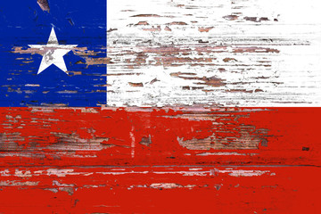 National flag of Chile on a dull wooden background