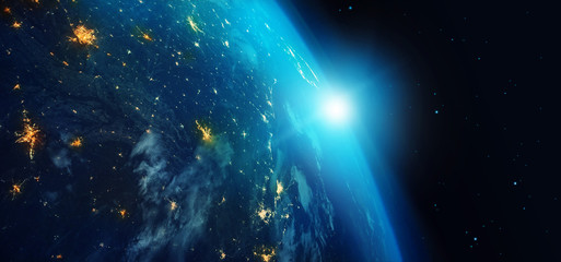 Earth from space at night with city lights and blue sunrise on stars background. 3d rendering. Elements of this image furnished by NASA.