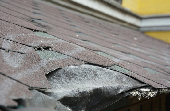 Asphalt shingles damage. Roofing shingles asphalt. Fixing damaged roof shingles.