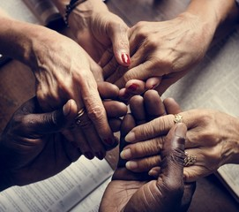 Hands of diverse religious shoot