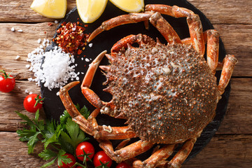 Preparation for cooking food spider crab with fresh ingredients close-up on a table. horizontal top view