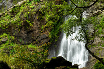 Beautiful waterfall in the national park forest at Khlong Lan Waterfall, Kamphaeng Phet Thailand