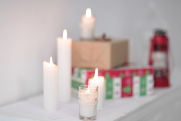 blurred image. candles and gift boxes .photo with copy space