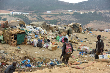 Refugees from Ghana and Guinea search for food at a garbage dump in Fnideq, Morocco, close to the Spanish enclave Ceuta