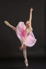 Beautiful ballerina standing on toes in pink tutu