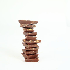 high stack of slices of original milk chocolate .isolated on whi