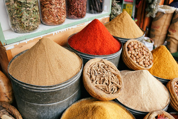 Piles of traditional spices in souk, market in medina of Marrakech, Morocco.