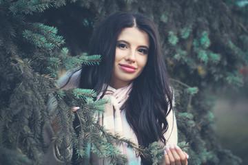 Smiling woman outdoors. Beautiful brunette girl portrait