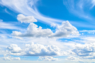 Sky landscape of cloudy sky. Blue vast sky background with colorful clouds and sunshine