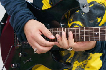 Somebody playing guitar. The image of guitar player hands and guitare