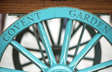 Covent Garden written on the famous flower cart wheel, welcoming tourists