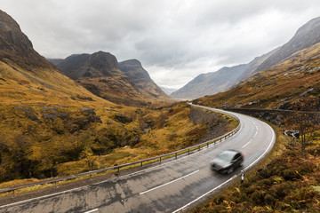 UK, Scotland, scenic road through the mountains in the Scottish highlands near Glencoe with a view on the Three Sisters