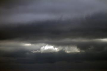 Sky, rain clouds background. Cumulonimbus in the dark sky. Thunderstorm