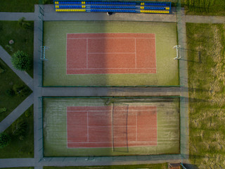Two tennis courts top view. Summer photography from a bird's-eye view