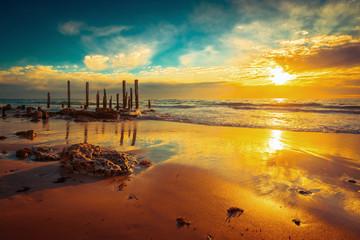 Port Willunga beach with jetty pylons at sunset