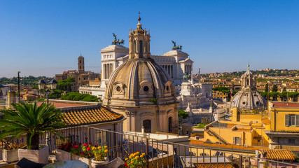 Photo of the sights and architecture of the centre of Rome from the roof of the historic building, day, summer: Forum, Catholic churches