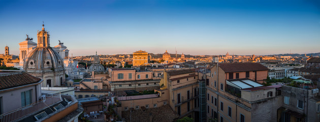 Beautiful panoramic view of the historical architecture of Rome from the roof of the building: Forum, Catholic churches, Vatican, Pantheon and other attractions in the morning sun