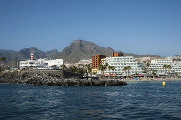 View from the ocean of the popular resort of Las Americas for its port restaurants, pubs and bars, entertainment and night life venues in the south of Tenerife, Costa Adeje, Canary Islands, Spain