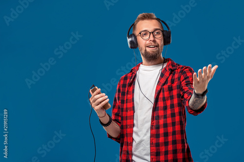 Happy Young Man Listening To Music With Headphones Handsome