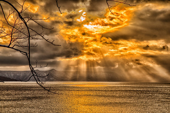 sky breakthrough over the sea with dark cloud and orange sun light, very amazing sky in the winter