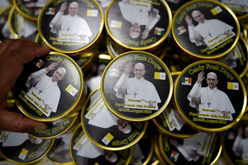 Tins of sweets with a picture of Pope Francis on the lid are seen for sale at the Pastoral Congress at the World Meeting of Families in Dublin, Ireland