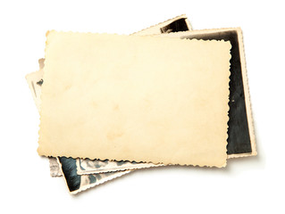 Stack old photos isolated on white background. Mock-up blank paper. Postcard rumpled