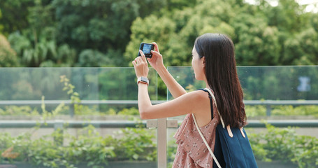 Woman taking photo on cellphone in Shum Yip upperhills