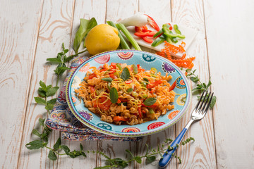 pasta with capsicum tomatoes and mint leaf