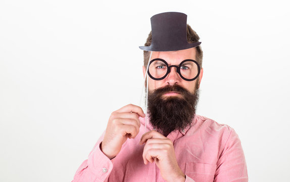 Signs someone is smarter than you. Guaranteed ways appear smarter. Tricks to seem smarter than you are. Man bearded hipster hold cardboard top hat and eyeglasses to look smarter white background