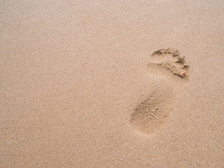 close up footprint on sand at the beach background