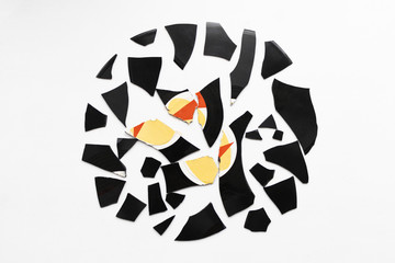 small pieces of broken vinyl. abstractly stacked in a circle on white background. isolated