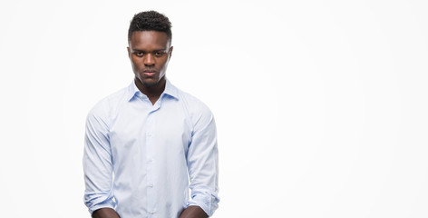 Young african american man wearing a shirt with a confident expression on smart face thinking serious