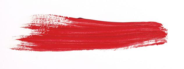 Red brush stroke isolated over white background