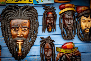 Wall art wood carvings on display for sale at a local craft market in Montego Bay, Jamaica