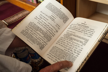 Canberra, ACT, Australia - October 2006: Man reads from English language Quran in Canberra mosque