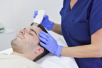 Young man on face treatment