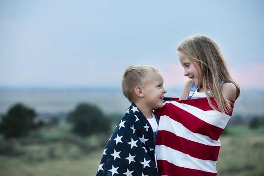 Boy and girl holding American flag