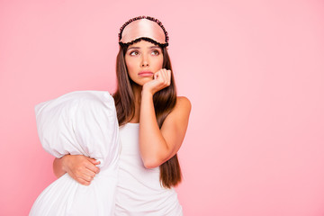 Young gorgeous sad minded lady wearing eye mask, hugging pillow,
