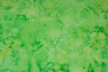 green watercolor ink painted on paper background texture