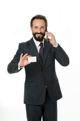 Feel free to call me anytime. Businessman hold plastic blank white card copy space. Businessman carries business card. Call this number. Contact for cooperation. Man speak phone support line