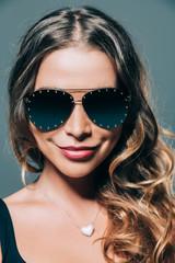 Smiling girl in sunglasses