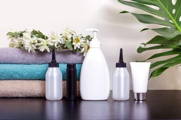spray dispenser tube towel paint hair deodorant gel table leaves green monstera white blue towel black chamomile wreath
