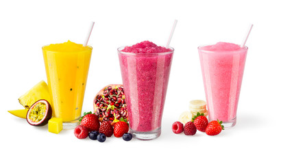 Three Flavors of Cold Fruit Juice Smoothies in Glasses with Straws and Garnishes on White Background