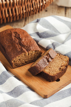 Pumpkin loaf cake on rustic wooden board