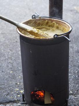 cook porridge in  copper cauldron