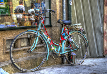 Old bicycle in font of a shop