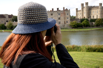 the woman is photographing the castle