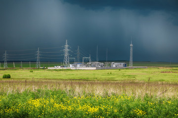Electric substation in the field during a thunderstorm
