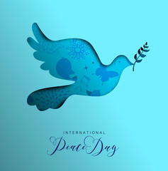 World Peace Day card of paper cut dove bird